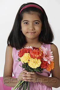 PictureIndia - Girl holding bouquet of flowers