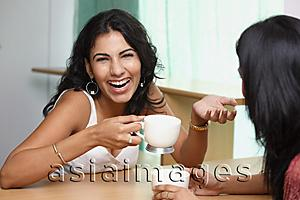 Asia Images Group - two young woman having coffee