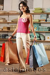 Asia Images Group - lady with shopping bags