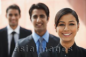 Asia Images Group - smiling businesswoman, two businessman in background