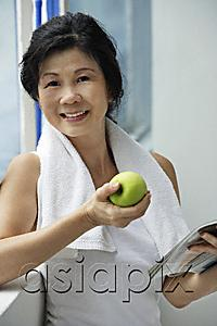AsiaPix - Woman eating apple after work out