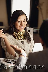 Asia Images Group - smiling woman sitting with man and discussing