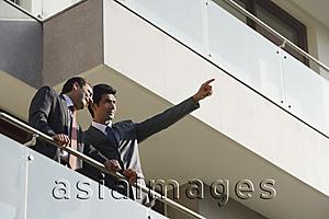 Asia Images Group - businessmen standing on balcony