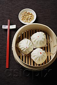 AsiaPix - Steamed buns in bamboo steamers with red chopsticks