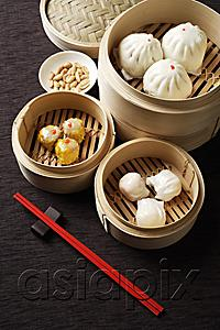 AsiaPix - Assortment of dim sum in bamboo steamers.