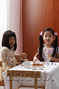 AsiaPix - two little girls having a tea party