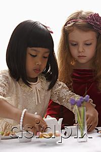 AsiaPix - two young girls having a tea party