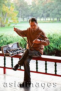 Asia Images Group - China,Beijing,Temple of Heaven Park,Man Playing Erdu Traditional Stringed Instrument