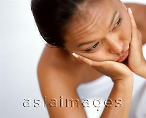 Asia Images Group - Woman resting chin on hands, portrait, white background