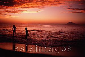 Asia Images Group - Indonesia, Sulawesi, Manado, Sunset on beach at Bunaken Island.
