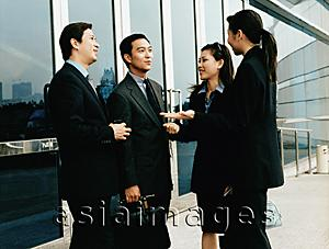 Asia Images Group - Executives meeting outside building.