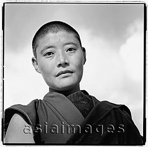 Asia Images Group - India, near Dharamsala, Dolma Ling Nunnery, Portrait of Tibetan nun.
