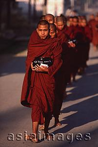 Asia Images Group - Myanmar (Burma), Nyaungshwe, Inle lake, Buddhist monks returning to monastery after collecting alms.
