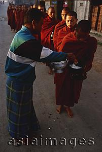 Asia Images Group - Myanmar (Burma), Inle lake, Buddhist monks receiving alms.