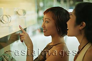 Asia Images Group - Two women in front of shop window,
