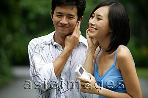 Asia Images Group - Couple listening to MP3 player