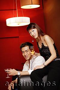Asia Images Group - Couple, holding drinks, looking at camera