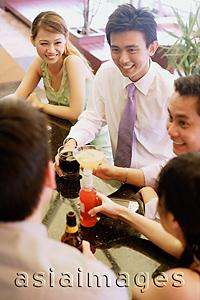Asia Images Group - Group of young adults talking at bar ( high angle view)