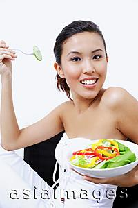 Asia Images Group - Woman holding bowl of salad, smiling at camera