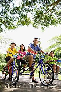 Asia Images Group - Family, on bicycles, portrait, low angle view