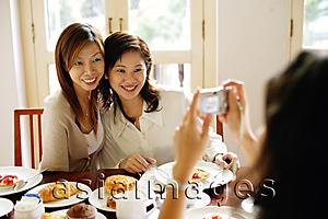 Asia Images Group - Women posing for photograph