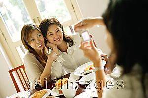 Asia Images Group - Women posing for photograph, smiling