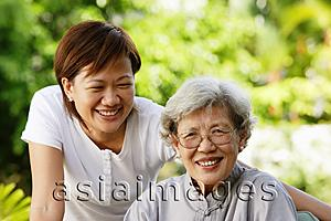 Asia Images Group - Two women, smiling at camera