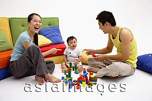 Asia Images Group - Family with one child, sitting on floor, playing with toys