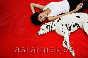 Asia Images Group - Woman with Dalmatian on red blanket