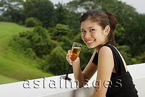 Asia Images Group - Young woman with champagne glass