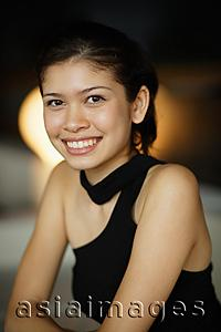 Asia Images Group - Young woman smiling at camera, portrait