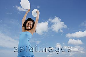 Asia Images Group - Woman holding balloons in air