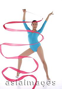 Asia Images Group - Woman performing rhythmic gymnastics with ribbon