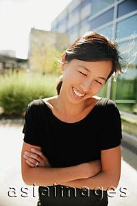 Asia Images Group - Woman smiling and looking down, outdoors