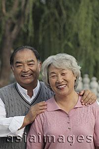 Asia Images Group - Older couple smiling together outdoors