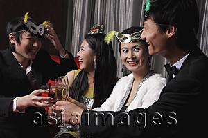 Asia Images Group - Two couples celebrating at a party together