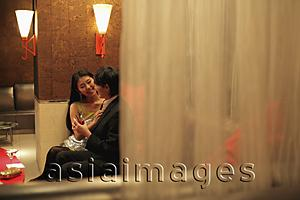 Asia Images Group - Young couple sitting in a club at night