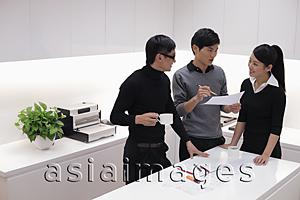 Asia Images Group - Three people working together in modern office