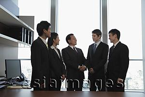 Asia Images Group - Small group of business people talking together