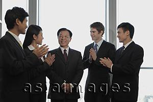 Asia Images Group - Small group of business people smiling and clapping