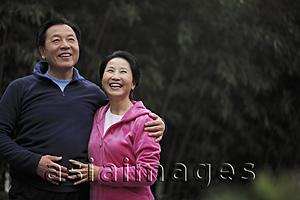 Asia Images Group - Senior couple embracing and laughing