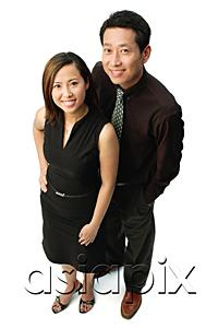 AsiaPix - Couple standing, looking at camera, smiling