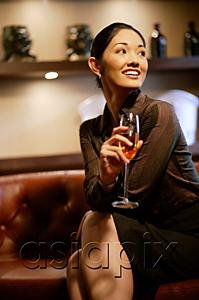 AsiaPix - Woman with champagne glass, smiling, looking away