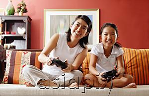 AsiaPix - Mother and daughter in living room, playing video game