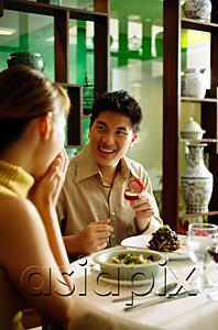 AsiaPix - Couple in restaurant, man proposing with ring