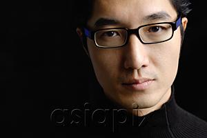 AsiaPix - Man wearing black glasses, looking at camera