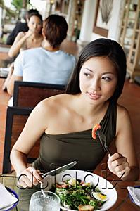AsiaPix - Woman having a meal in restaurant