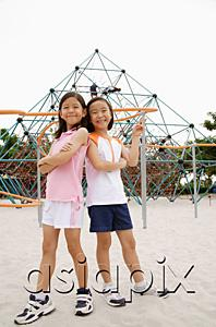 AsiaPix - Girls at playground, standing back to back, smiling at camera