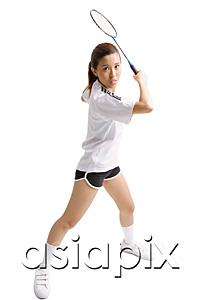 AsiaPix - Young woman holding badminton racket, waiting to swing