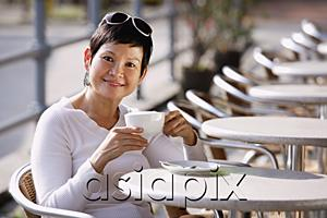 AsiaPix - Mature woman in cafe having a drink